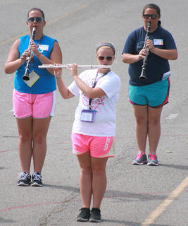 From left, sophomore Melissa Clark, junior Kelsey Hamilton and sophomore Allison Sallee practice with the woodwinds.