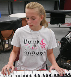 Freshman Brooke Davis works on learning this year's music on the keyboard.