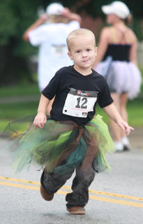 Aiden Knopp, 4, is more than man enough to run in a tutu.