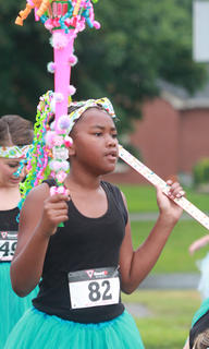 Denisha Epps carries a couple spirit sticks during the run.