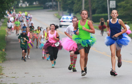 For a short time, tutu clad runner take over Spalding Avenue.