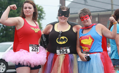 The Back Tutu School run had (from left) Savannah Browning, Stephanie Keeling and Sharon Mosz feeling heroic.