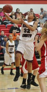 Kyvin Goodin-Rogers puts in two of her 14 points in her teams win over Taylor County in the 20th district tournament opener.