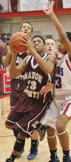 Anton Cowherd finds his way to the bucket in Marion County's game against Adair County in the 20th district tournament.