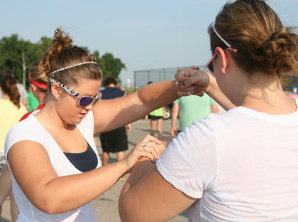 The Marion County High School Marching Knights started two weeks of band camp last week. The came will wrap-up Friday, Aug. 3, with a special event for the public. At 6 p.m. Friday at the high school, the band will host a free community cookout and performance, according to band director Curtis Bennett. Instructor Ashley Mann shows freshman Anne Kaitlyn Gribbins the correct form for holding her flag for the color guard.
