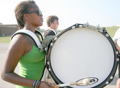 Sophomore Paris Manson marches and plays a bass drum during band camp.