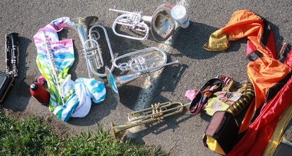 As the band members worked on their marching form, their instruments and color guard flags were placed to the side.