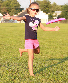 Haley Jo Thomas, 5, tosses a Frisbee before the movie begins.