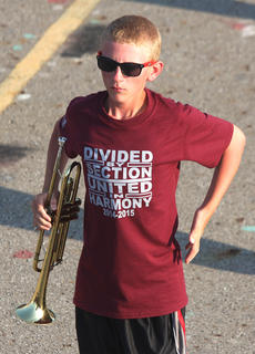 Trumpet player Aaron Mattingly, sophomore, holds his pose at the end of Friday's performance.