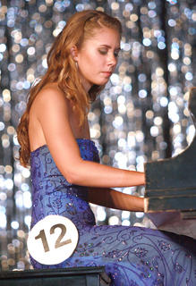 Gabrielle Hamilton plays the piano.