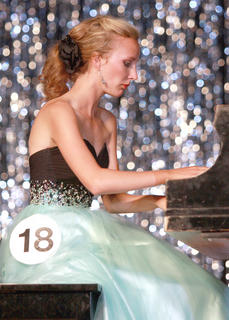 Elyssa Holt plays the piano.