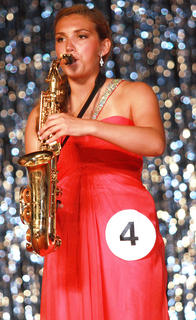 Madison Cassidy plays the saxophone as her talent.