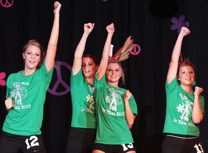 From left, Lacey King, Natalie Hutchins, Josie Lyon and Catharine Ball perform their fitness routine.