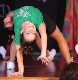 Jo Ann Elder, a fitness award winner, shows her flexibility during the fitness portion of the competition.