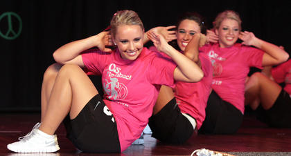 From left, Rachel Bell, Megan Caldwell and Ann Clair Carter keep smiling while working their abs.
