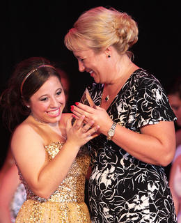 Third runner-up Taylor Corbett accepts one of her awards from Mary Taylor, co-judges chairperson.