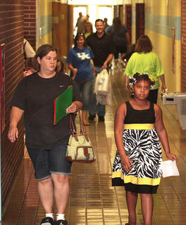 Third-grader Typrasia Furmon walks down the hall at Lebanon Elementary before classes begin.
