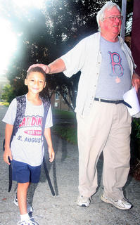 Leo Hamilton accompanies his grandson, Jesse, a second grader at St. Augustine on the first day of school.
