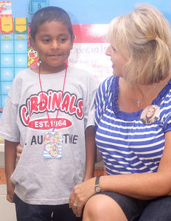 David Castillo introduces himself to his classmates in Gina Carter's  kindergarten/first grade class.