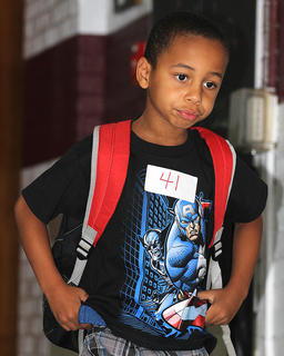 Looking confident, Travarious Bryant walks down the hall towards his classroom at Lebanon Elementary School.