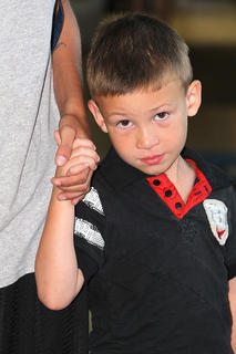 Tristan Scott holds on to his mother's (Catherine Scott's) hand at Lebanon Elementary School.