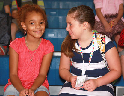 Second-graders Dezire Maddox, left, and Mia Mattingly chat before classes begin at Glasscock Elementary School.