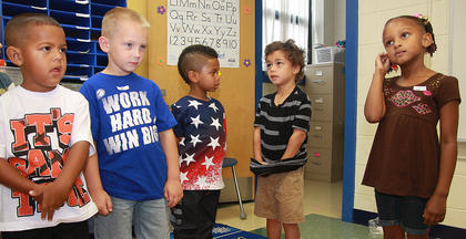 From left, Xavier Hayden, Konner Goodin, Pejaun Owens, Gabriel Washington, Yumiko Bell introduce themselves in Melissa Hutchins' kindergarten class at Glasscock Elementary School.
