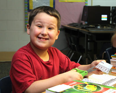 Anthony Rollings shows no signs of first day jitters as he works on an activity at his desk at Calvary Elementary.