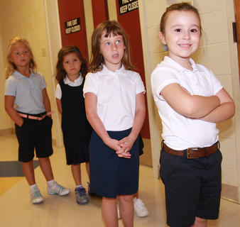 St. Augustine kindergartners wait for their turn to get a drink of water. From front to back, they are Lila Filatreau, Sarah Jane Ford, Katie Zink and Lainie Mattingly.