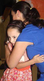 Chloe Robbins gives her mother a hug.