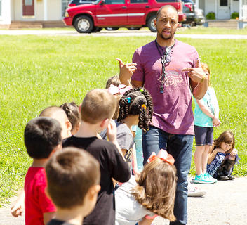 New Lebanon Elementary School physical education teacher, George Boyd, leads Lebanon Elementary School students through a game of Simon Says.