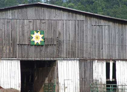 "Eula Ray and Sonny Kirkland's barn quilt, ""Kirkland Star,"" is displayed on a old barn that's nestled into the countryside on Hw   y. 337 in Gravel Switch."