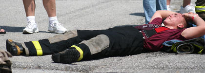 Cody Thompson of the Raywick Fire Department takes a break after the bucket brigade event.