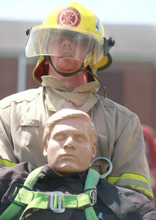Jeremy Nalley of the Loretto Fire Department drags a 200-pound dummy in the last leg of the relay challenge.