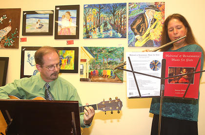 "Dr. Lisa McArthur, flute professor at Campbellsville University, and Larry ""Fella"" Wilson, pastor at Woodlawn Christian Church in Campbellsville, play renaissance music before the play Friday evening."