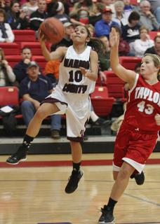 Haeli Howard floats to the basket for two points in the opening game of the 20th district tournament.