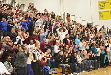 Marion County fans filled the Green County gym to cheer the Lady Knights to their fourth consecutive regional championship.