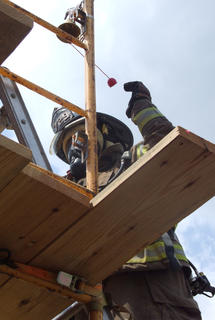 Matthew Riggs of the Raywick Fire Department rings the bell after climbing a ladder in the final event.