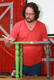 Lee Guilfiol demonstrates techniques to improve an end table found at a yard sale.