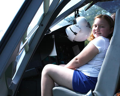 Ready for take-off! Becca Hayes, 12, sits in the cockpit of a helicopter normally used for saving lives.  