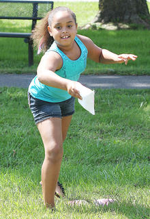 Mercede Douglas, 9, plays cornhole during Family Fitness and Safety Day.