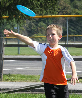 Gabe Nelson, 8, tries his hand at disc golf during Family Fitness and Safety Day.