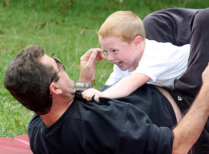 Ben Lews, 6, takes down John Cox with his martial arts skills Saturday afternoon at Family Fitness and Safety Day.