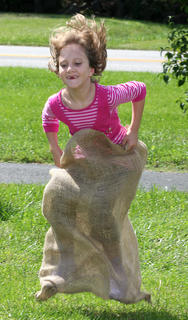 Cheyenne Brady, 7, competes in the sack races at Family Fitness and Safety Day.