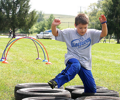 Gavin Spalding, 6, participates in the Marion County High School ROTC obstacle course Saturday afternoon.