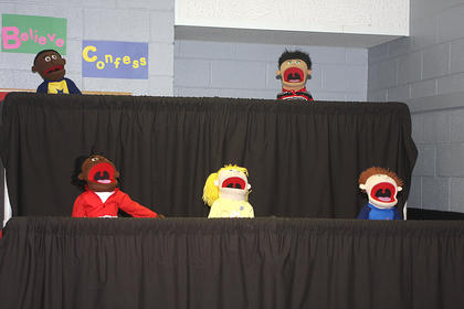 Scene 2: In scene two, people see the children in action with their puppets during play practice. They are (from left) Erin Cox, Abigail Bramel, Emma Cox, Anne Kaitlyn Gribbins, Will Sallee, and Kelly Wise.