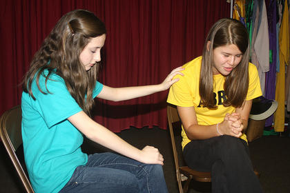 Scene 3: Paige Reed (Sarah) and Anna Stewart Burdette (Abby) pray together and Abby accepts Jesus Christ as her savior.