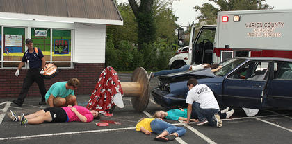 Scene four: There is a violent car crash and several people are killed.