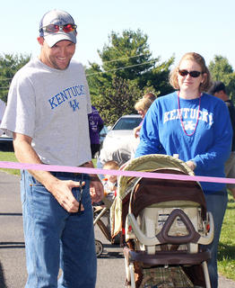 Kirk Cecil cuts the ribbon to get the March for Babies started. He and his wife, Amy, and their son, Luke, were the ambassador family for this year's event.
