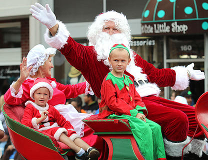 Santa, Mrs. Claus and some of their helpers from Ruley's Santa Claus Land in Loretto add some early holiday cheer to the Pigasus Parade.
